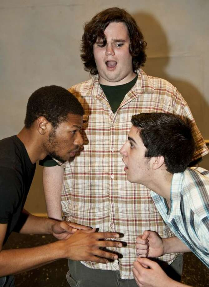 King Sextimus the Silent (left, Dillon Dewitt of Alvin) begins to tell his grown son, Prince Dauntless the Drab (right, Chase Folwell of Dickinson) about the birds and the bees, while the Court Jester (Sammie Ford of Dickinson) looks on in a rehearsal of Alvin Community College's production of the lighthearted musical Once Upon a Mattress. Photo: Courtesy ACC