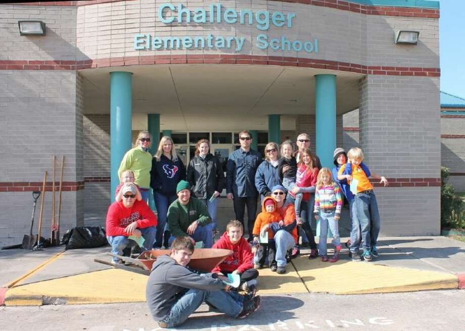 Parishioners from St. Andrew's Episcopal Church recently beautified the entryway of Challenger Elementary. Photo: Courtesy Pearland ISD Communicat