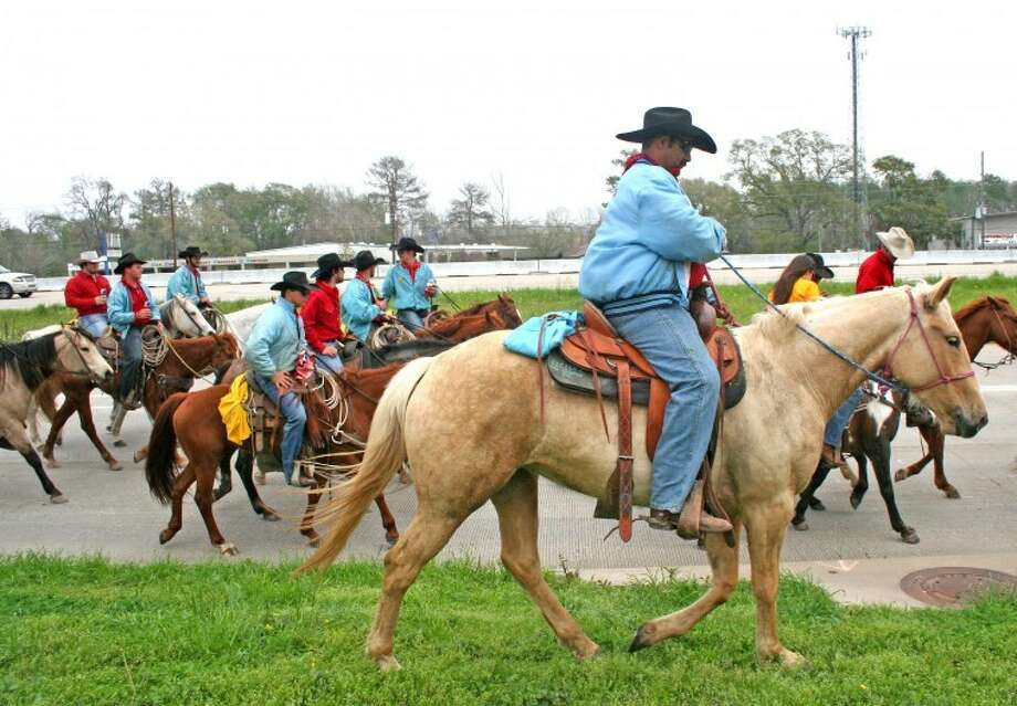 Riders take the Highway 249 feeder in northwest Harris County as they continue the 70-mile Sam Houston Trail Ride, established in 1955. Photo: REBECCA BENNETT/THE MIRROR
