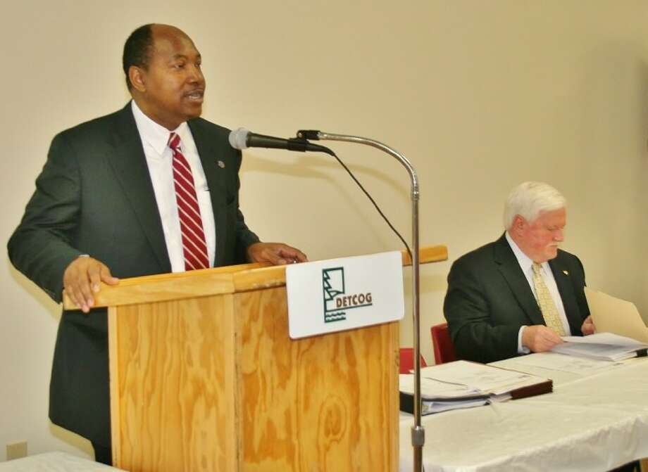 DETCOG Executive Director, Walter G. Diggles, Sr. addresses the DETCOG meeting on the Texas Medicaid 1115 Waiver Thursday in Crockett. Also shown is DETCOG Second Vice-President, Angelina County Judge Wes Suiter. Photo: Submitted Photo