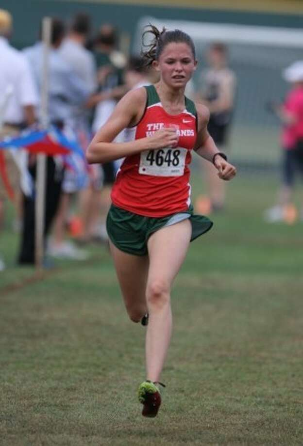 Madi McLelland of The Woodlands won the 1,600-meter run in the Kingwood Zoe Simpson Track and Field Meet, with a time of 4:57.34.