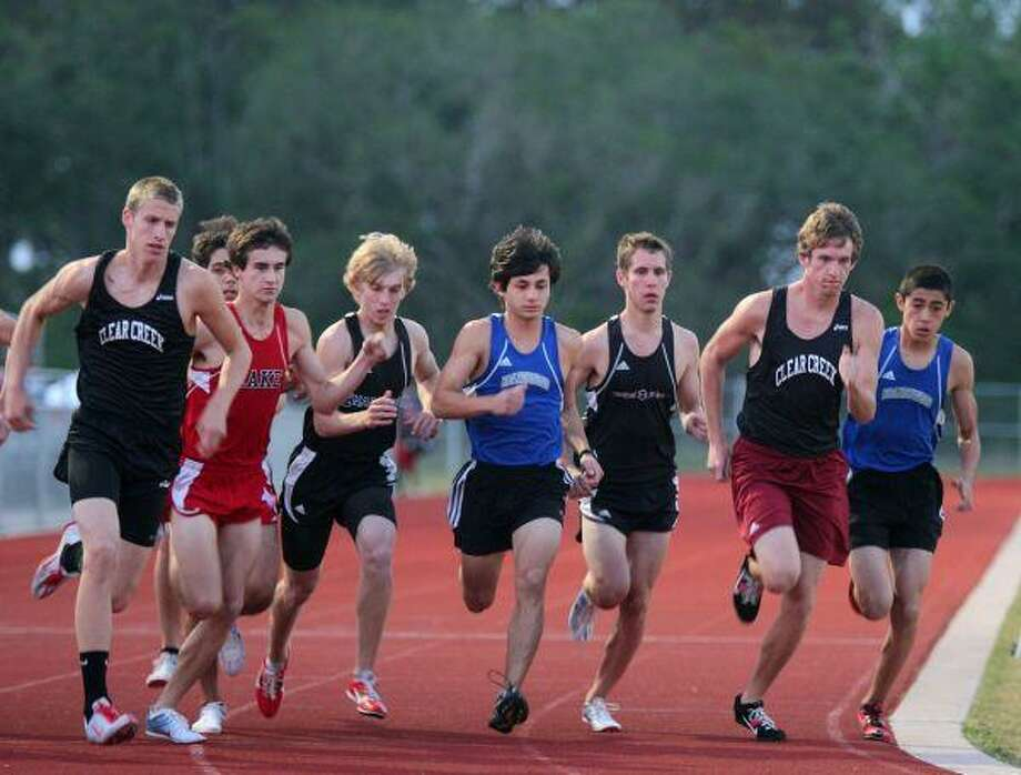 The boys start the 1600 meter run.