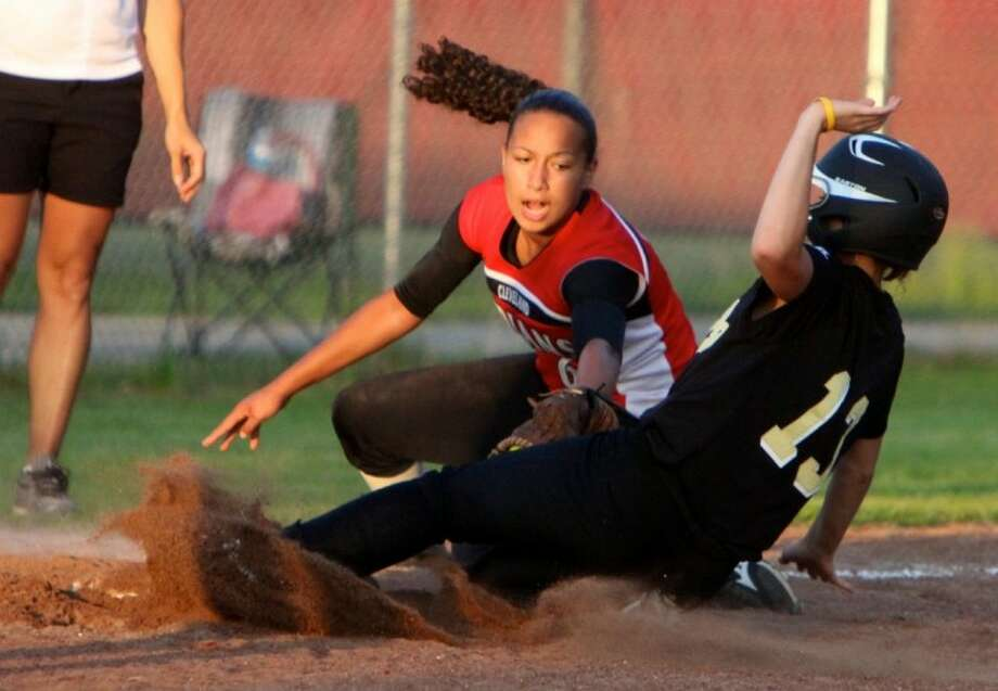 Cleveland shortstop Aurora Burks couldn't beat Emily Scott as she steals third base during the first inning.