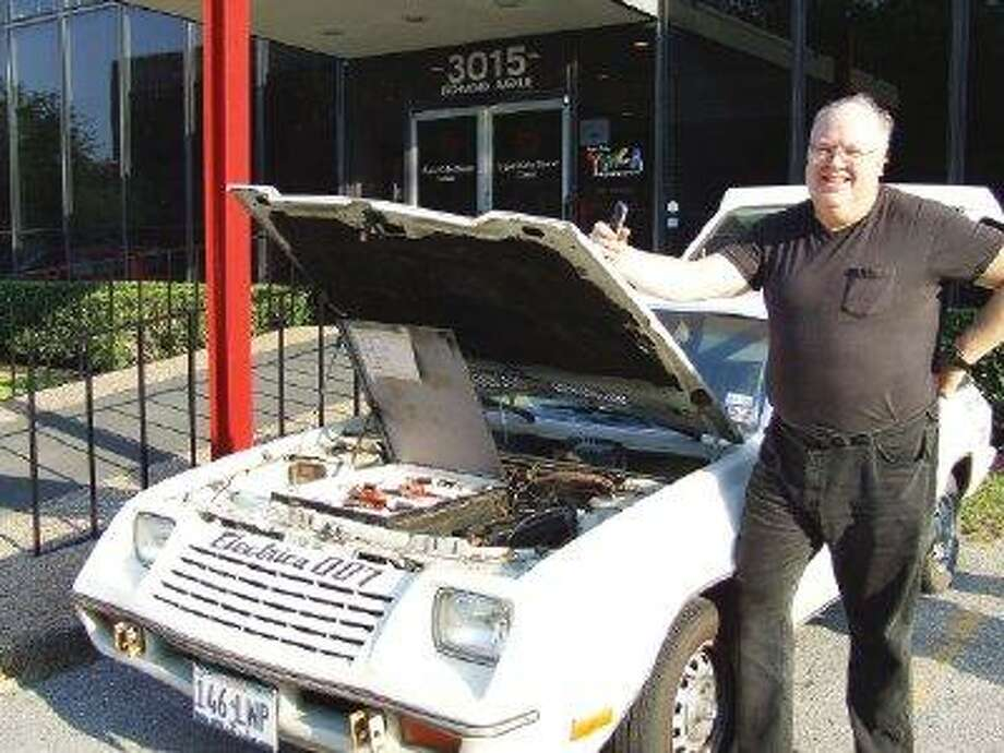 Dale Brooks, president of the Houston Electric Auto Association, shows off the Electrica 007. / @WireImgId=343216