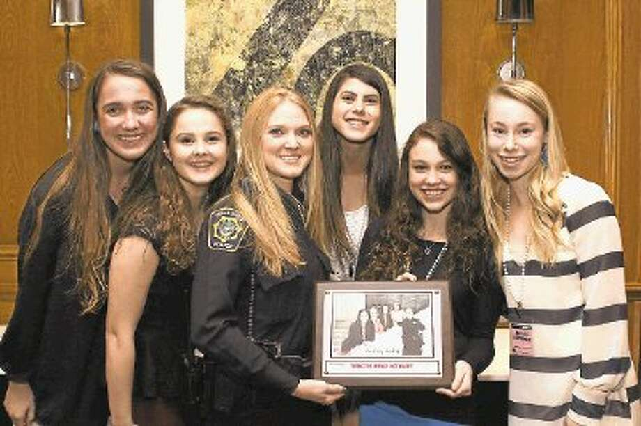 Bellaire residents and BHS sophomores Kate Campbell, Maddie Bergoon, Sydney Scherer, Meagan Applebaum and Abigail Newhouse present Bellaire Police Officer Tracie Mathews (center) an award for serving as their key note speaker at the Leading Ladies' 2013 Dinner. / @WireImgId=2615147