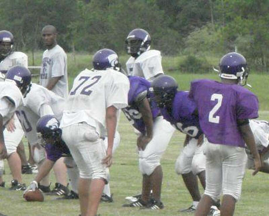 Humble quarterback Keith Baker scans the defense before taking a snap during the Wildcats' practice Tuesday afternoon.