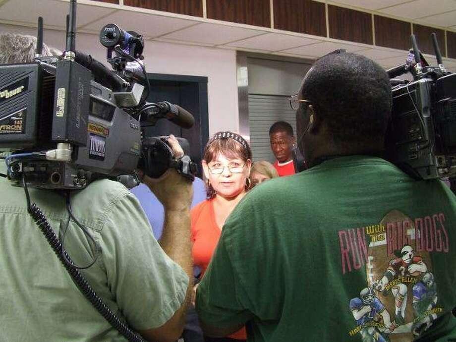Rosa Perez speaks to the media at the ACORN protest Thursday morning.
