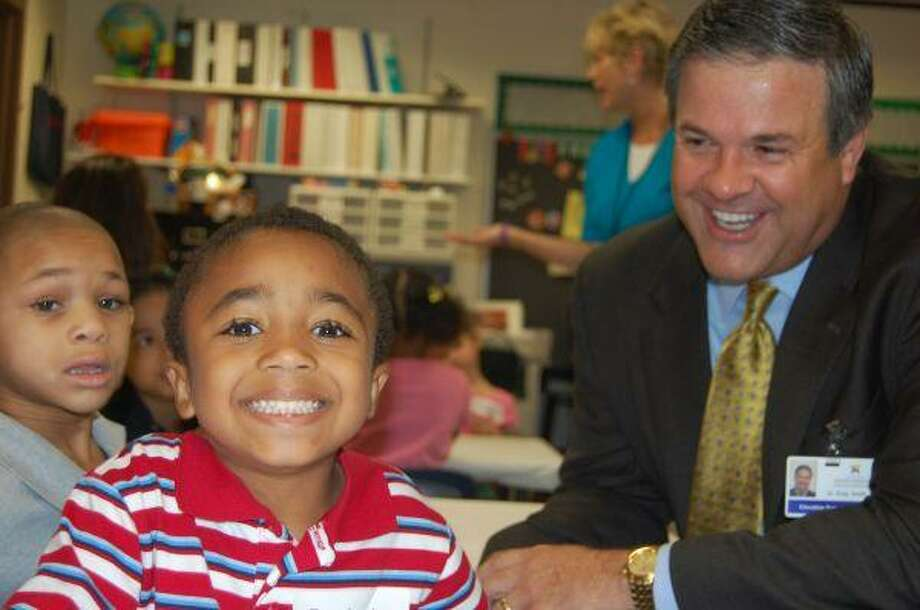 It was smiles all around for the kindergarten students in this McWhirter Elementary classroom, where Superintendent Dr. Greg Smith looks on.