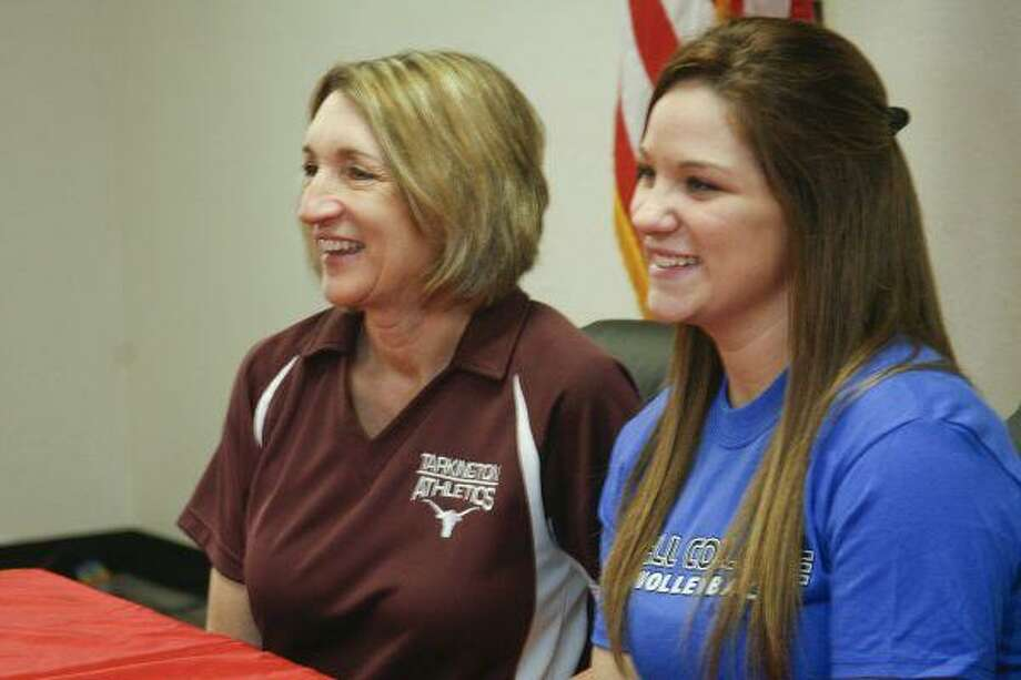 Tarkington head volleyball coach Denise Johnson poses for a photo with Lauren Myers after the Tarkington senior signed a letter of intent with Hill College on February 5.