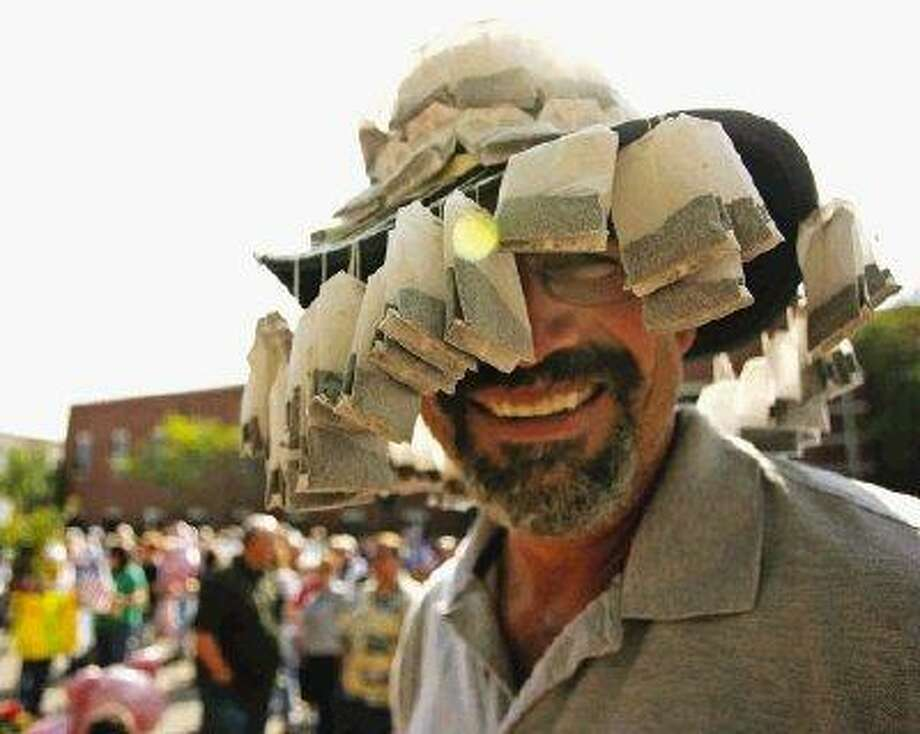 Phill Cady of Conroe wears a hat adorned with tea bags during last Wednesday's Conroe Tea Party tax day protest in downtown Conroe.