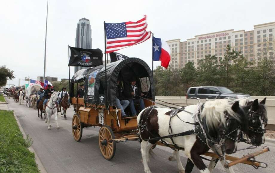Photo by Alan Warren/The Mission Trail Riders come down the I-610 West Loop access road near the Galleria on the way to Memorial Park in Houston on Friday, Feb. 24.