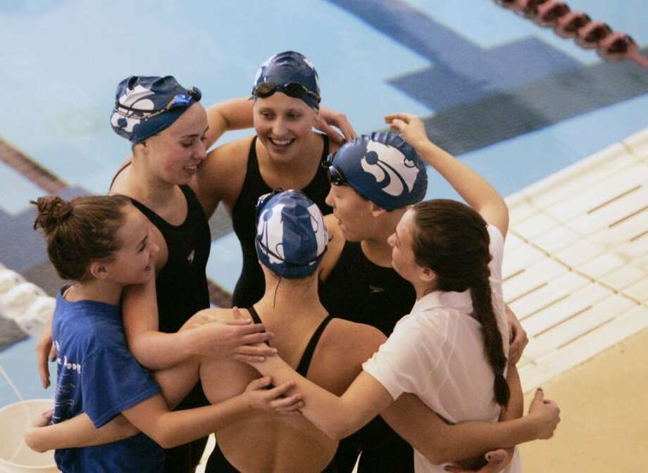 Pictured is the Cy Creek girls 200 and 400-yard freestyle relay team after winning the 400-yard freestyle relay at the Region V Swimming and Diving Championships last weekend in Conroe. Photo: Eric Swist