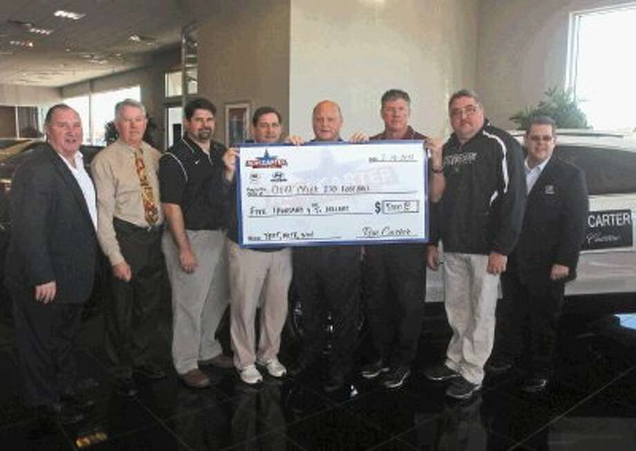 Clear Creek ISD football programs were on hand to receive checks from Ron Carter Cadillac after the public got to vote for their favorite football team. Jay Goslin (far left) and Chris Premont (far right) both with Ron Carter Cadillac presented the checks to (L-R), Bill Daws; CCISD Atheltic Director, Frank Maldonado of Clear Springs, Sam Smith of Clear Lake, Paul Lanier of Clear Brook, Darrell Warden of Clear Creek and Mike Zierlein of Clear Falls. Photo: Kar B Hlava