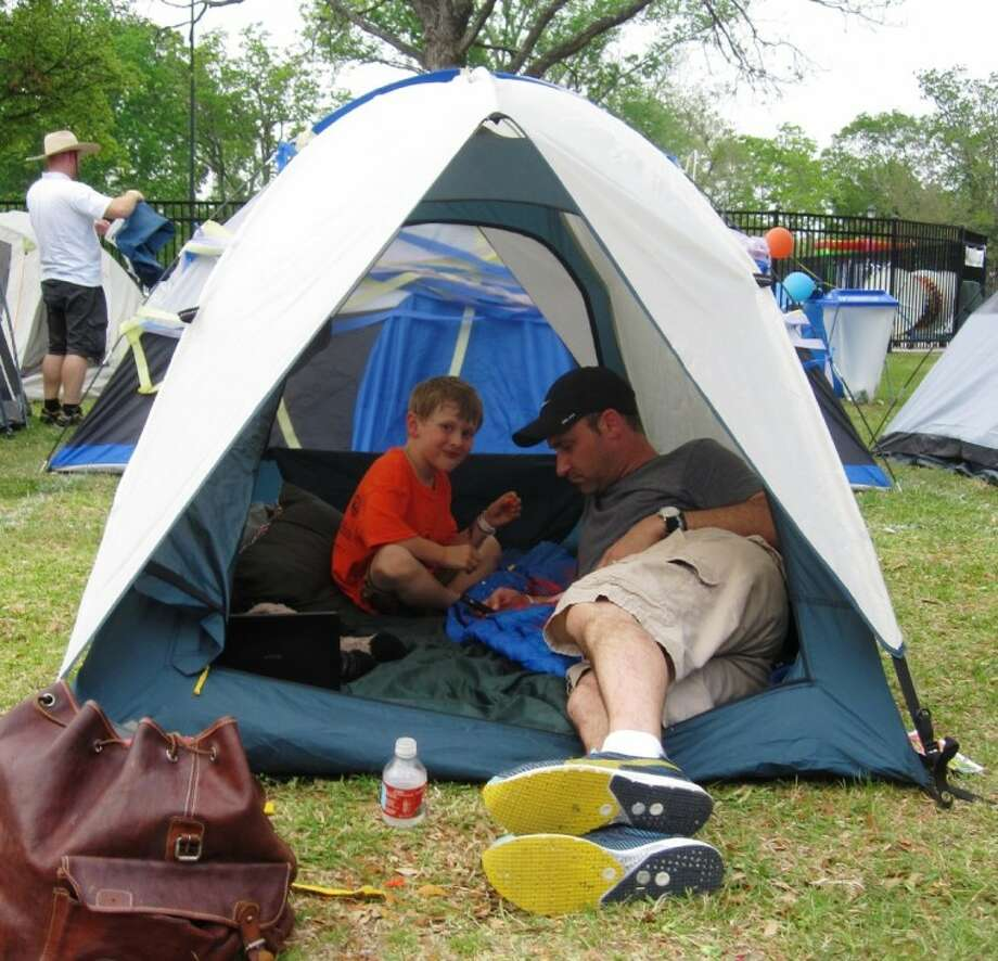 Even the wilds of Bellaire Town Square, parents participating in this weekend's Tents in Town can still stay connected to civilization via cell phone. Photo: CHARLOTTE AGUILAR