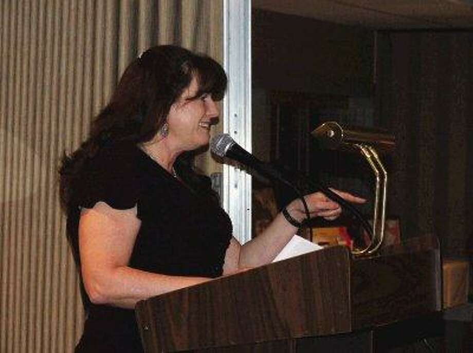 New Crosby Huffman Chamber of Commerce President Julie Gilbert keeps her board of directors from getting too rowdy during the Chamber's annual Installation and Awards Banquet on Feb. 19 at Monument Inn in La Porte.