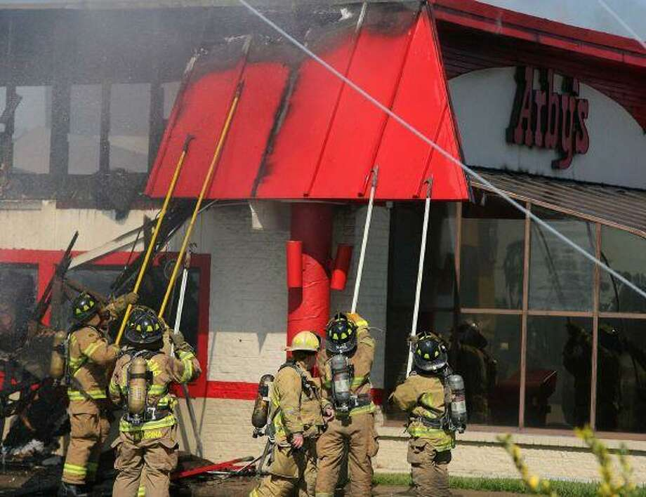 Pasadena firefighters tackle a fire at the Arby's on Spencer Highway near Center Street on Friday afternoon. The fast food eatery is determined to be a total loss.