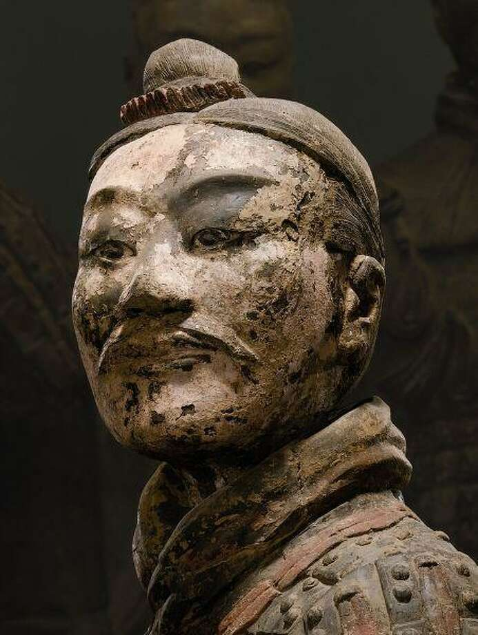 """This detail is of """"Kneeling Archer,"""" one of the artifacts included in the upcoming exhibition """"Terra Cotta Warriors: Guardians of China's First Emperor,"""" which opens May 22 at Houston Musuem of Natural Science. The clay with pigment soldier is from the Qin dynasty (221-206 B.C.) and was excavated in 2001."""