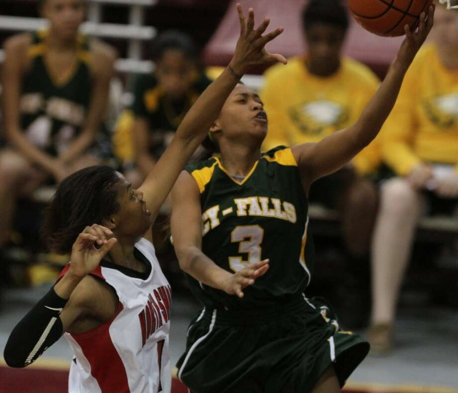 Cy-Falls' Sadalia Ellis (3) goes up for a layup during the girls Region III-5A regional semifinals game at the Campbell Center on Feb. 24. Cy-Falls defeated North Shore 50-27. Photo: Jason Fochtman