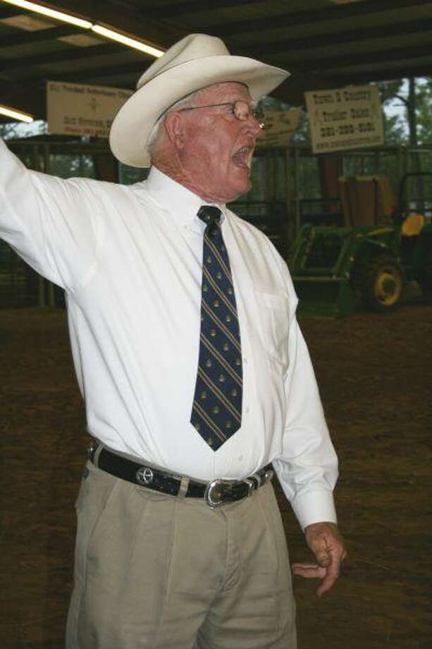 Cleveland Municipal Court Judge Bob Steely stirs up excitement at Friday night's livestock auction.