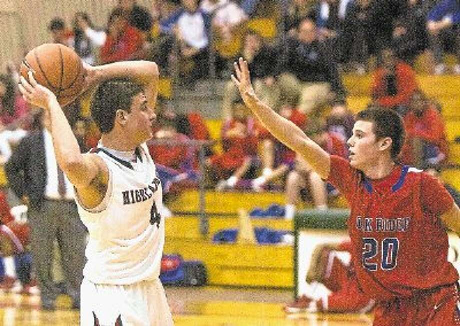 Brent Burress, right, and the Oak Ridge War Eagles face Spring Westfield in the Class 5A basketball playoffs tonight. / @WireImgId=2612073