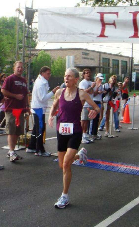 60-year-old Sabra Harvey with a world record finish at the Bellaire Trolley Run.