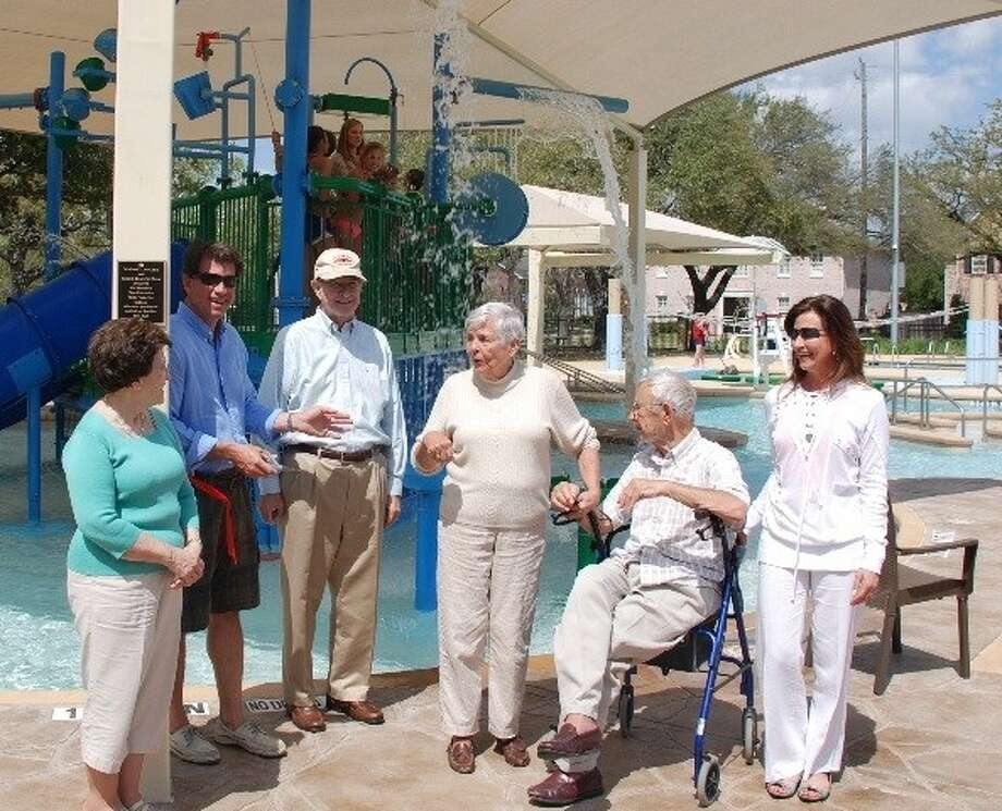 Generations of West University parks supporter include Joanne, Mike and R.L. (Dick) McCann, Mary Ann and Tom Binig and Cece Binig McCann, with McCann and Binig grandchildren on the platform. The families's legacy of park support was honored recently at Colonial Park Pool by the Friends of West University Parks.