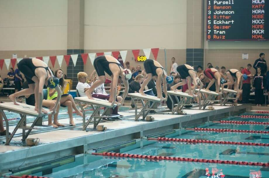 Kaleigh Ritter (second from left) was the top seed for the 500-yard freestyle finals at the Region 5-5A Championships, Feb. 11 at the University of Houston. The Bellaire senior won the race in 4 minutes, 56.67 seconds. Photo: Regina Eco