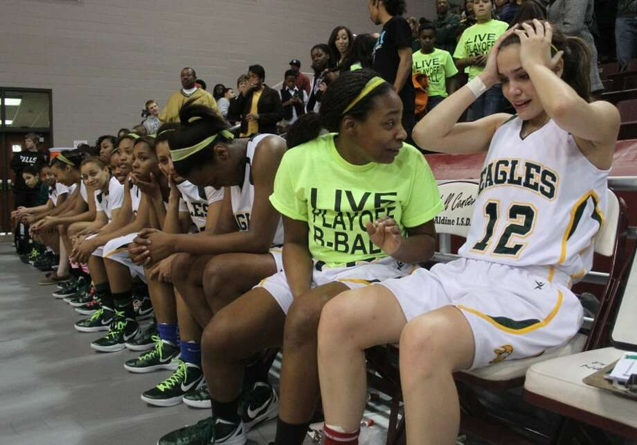 Kit Metoyer (12) sits in utter disbelief after Cy-Falls defeated Elsik 59-52 in the girls Region III-5A regional finals game at the M.O. Campbell Education Center on Feb. 25. Photo: Jason Fochtman