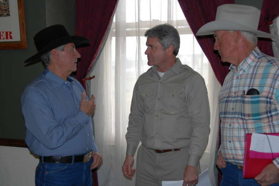 U.S. Rep. Michael McCaul, center, listens to Arizona residents while visiting the border on Monday.