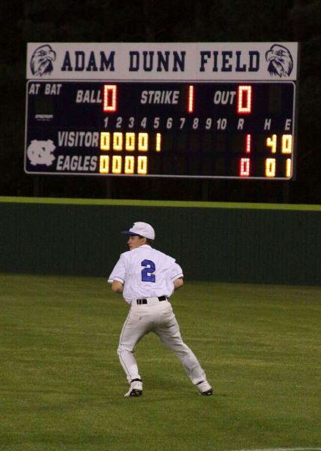 Josh Stubbs catches a fly ball for New Caney in its loss to Conroe Oak Ridge March 24.