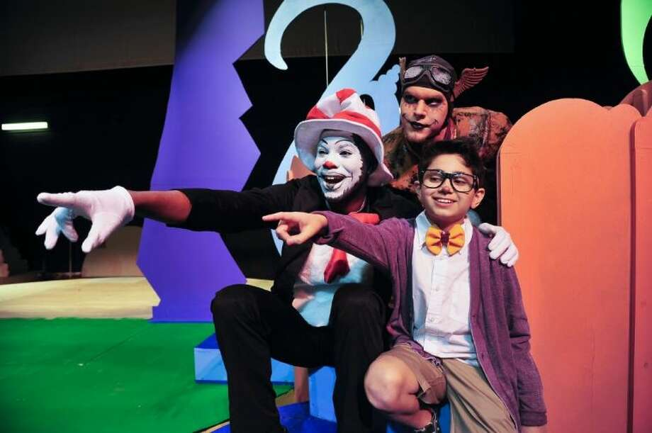 """The Cat in the Hat (Rich Scott from Pearland, left) shows JoJo (Nick Trevino, guest artist from Pasadena) a small Who, as Vlad (J D Mathis from Deer Park) looks on in San Jacinto College's production of """"Seussical: The Musical."""" Photo: ROB VANYA"""