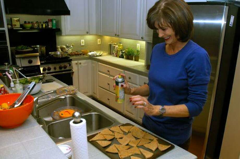 Lapin readies a sheet of chips cut from whole-grain tortillas for toasting.