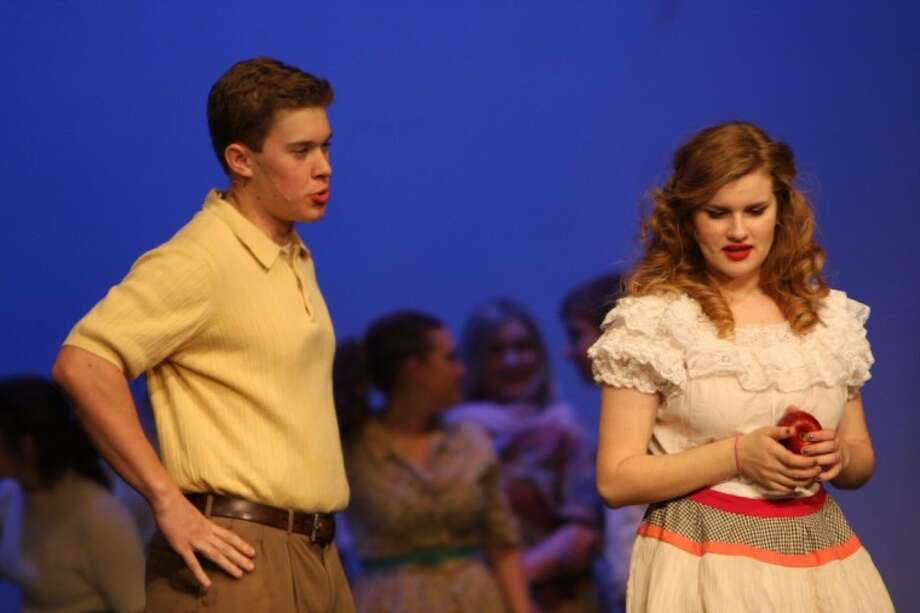 Sid (Tommy Stuart) is not interested in engaging in small talk with Babe (Elisabeth Del Toro). He wants news while performing in The Pajama Game, FHS' 44th musical in its last weekend Feb. 24-26 in the FHS auditorium. Photo: Courtesy Friendswood ISD