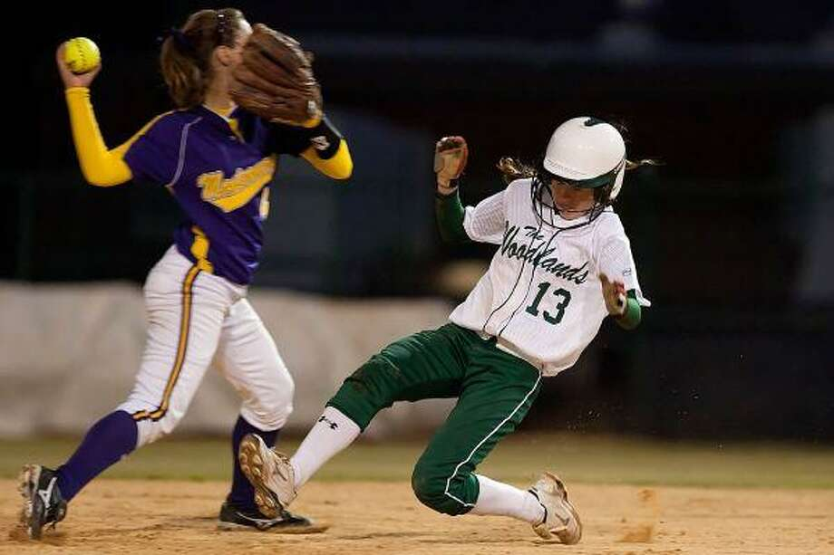 The Woodlands' Alyssa Jorgensen slides into second base in front of Montgomery's Devon Tunning during Wednesday night's game at Montgomery. / The Courier