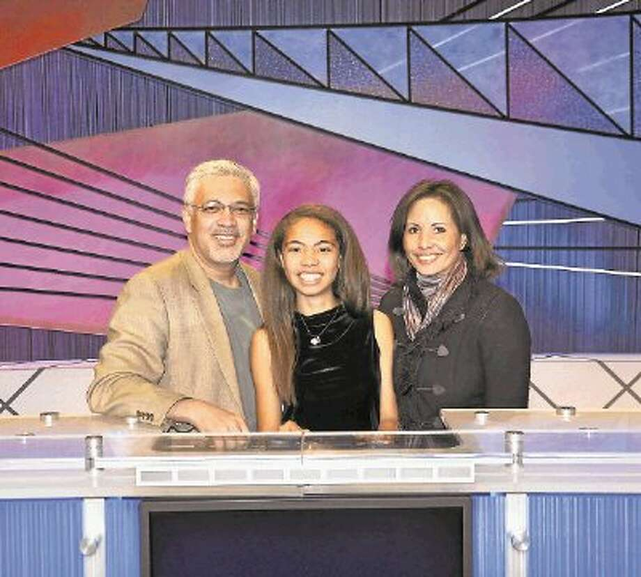 Irene Vazquez, center, on the set of the Jeopardy Teen Tournament with her parents, Jose and Sheryl Vazqyez of West University Place. / @WireImgId=2615959