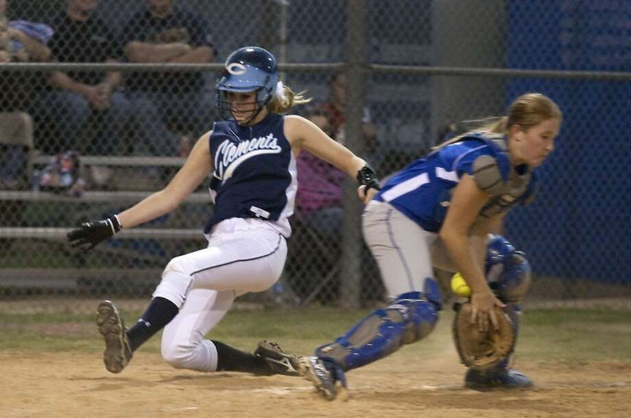 Elise Nieser slides home safely ahead of a throw in the fourth inning Tuesday night. Clements defeated Elkins, 5-2.