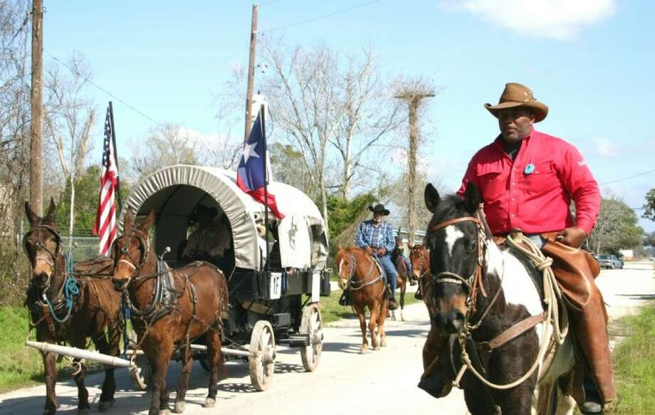 Trail Boss Anthony Bruno, right, brings the Northeast Trail Riders Association through Liberty on Feb. 21 en route to the Feb. 25 Downtown Rodeo Parade at the Houston Livestock Show and Rodeo. The journey began in Beaumont. Photo: STEPHEN THOMAS