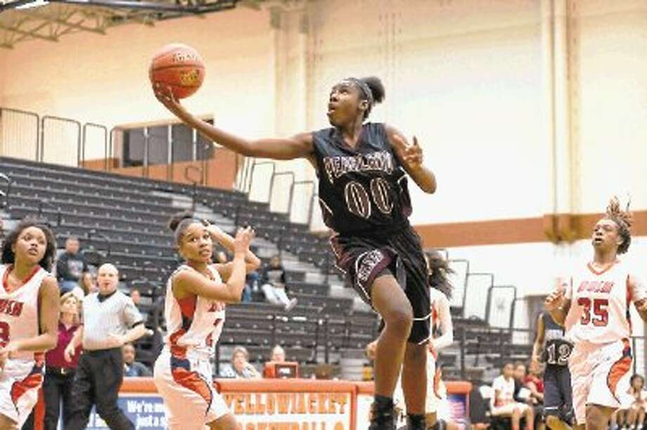 Pearland Lady Oiler guard Keara Hudnall, shown here against Fort Bend Bush, scored 18 points Tuesday night to lead Pearland to a 54-47 win over Galena Park North Shore. The win sends Pearland into this weekend's Region III-5A tournament. Photo: KIRK SIDES / @WireImgId=2615880