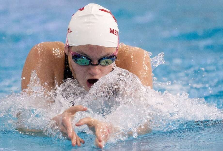 Memorial's Briana Burns competed in the 200-yard breaststroke at the UIL Class 5A state championships at the Lee and Joe Jamail Texas Swimming Center in Austin. Burns joined Danielle Yoon, Alexandra Buscher and Eliza Bornman in winning the bronze medal in the 200-yard medley relay. Photo: Eric S. Swist/HCN