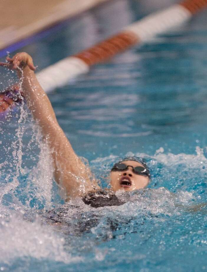 Dawson's Catherine Wu finished the 100-yard backstroke in 57.45 seconds, winning the bronze medal Saturday at the Class 4A state championships at the Lee and Joe Jamail Texas Swimming Center in Austin. Photo: Eric S. Swist/HCN