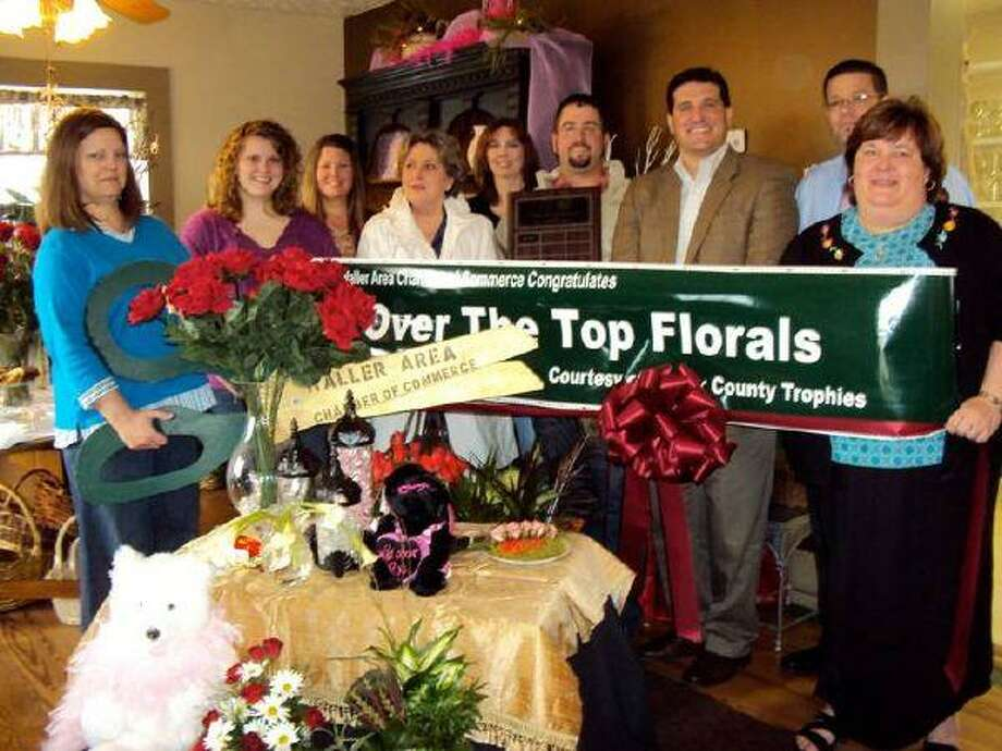 The Waller Area Chamber of Commerce held a ribbon cutting for Over The Top Florals, 30598 FM 1488, Waller (Field Store Area). Owners Karen Hatch (holding the scissors) and Lana Scarborough (holding the banner) said Over The Top Florals specializes in artistic floral designs. They are open Monday through Friday from 9 a.m. to 5:30 p.m. and Saturdays by appointment. Coffee is always on and they have Wifi service available.