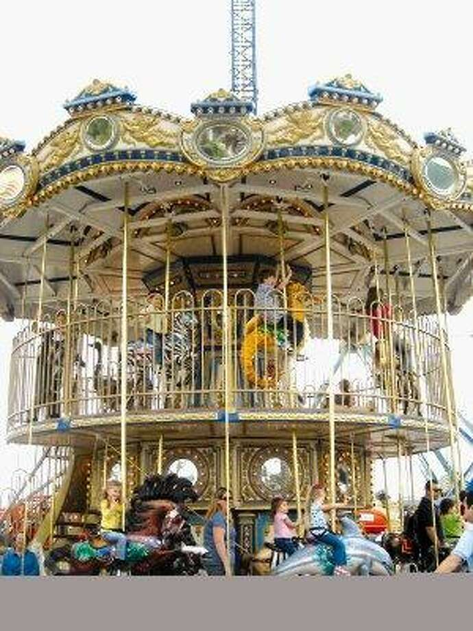 The Carousel is a prime attraction on the Kemah Boardwalk. / @WireImgId=748117