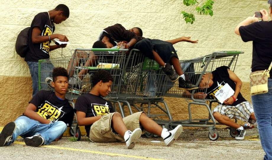 """These teens """"tag"""" being Above the Influence of homelessness during Saturday's Tag It event."""
