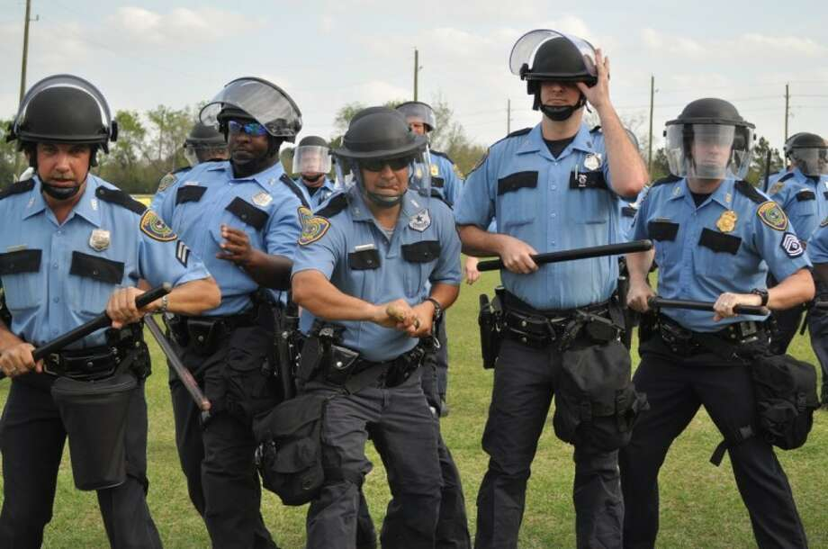 Houston Police Department's Special Response Group practices holding off unruly crowds during training exercises. (Photo by Paula Doerr/The Observer)