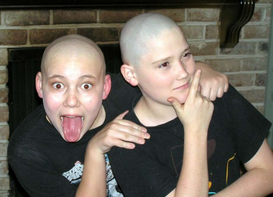 """Seventh graders Chris Elliott and Michael McDougal of Memorial Parkway Junior High School in Katy shaved their heads bald for their role as Mr. Oliver """"Daddy"""" Warbucks (on alternate nights) in the school's production of Annie Junior - the musical. Kylie Tidmore and Isabel Shantz, both sixth graders, will play Annie on alternate nights. The play opens this week at MPJH, located at the corner of West Green and Highland Knolls, and will run Thursday through Sunday. General admission is $6 at the door. March 1-3 at 7 p.m and March 4 at 3 p.m. For more information, call 281-237-5800."""