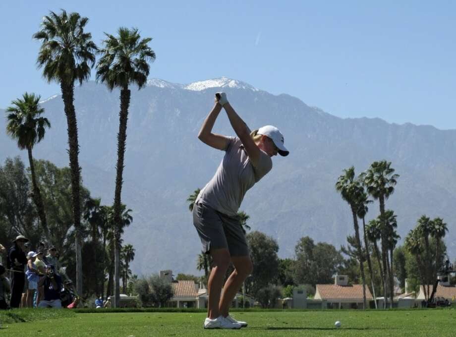 Stacy Lewis, a 2003 graduate of The Woodlands High School, hits her tee shot on the fifth hole during the final round of the LPGA Kraft Nabisco Championship in Rancho Mirage, Calif., on Sunday.