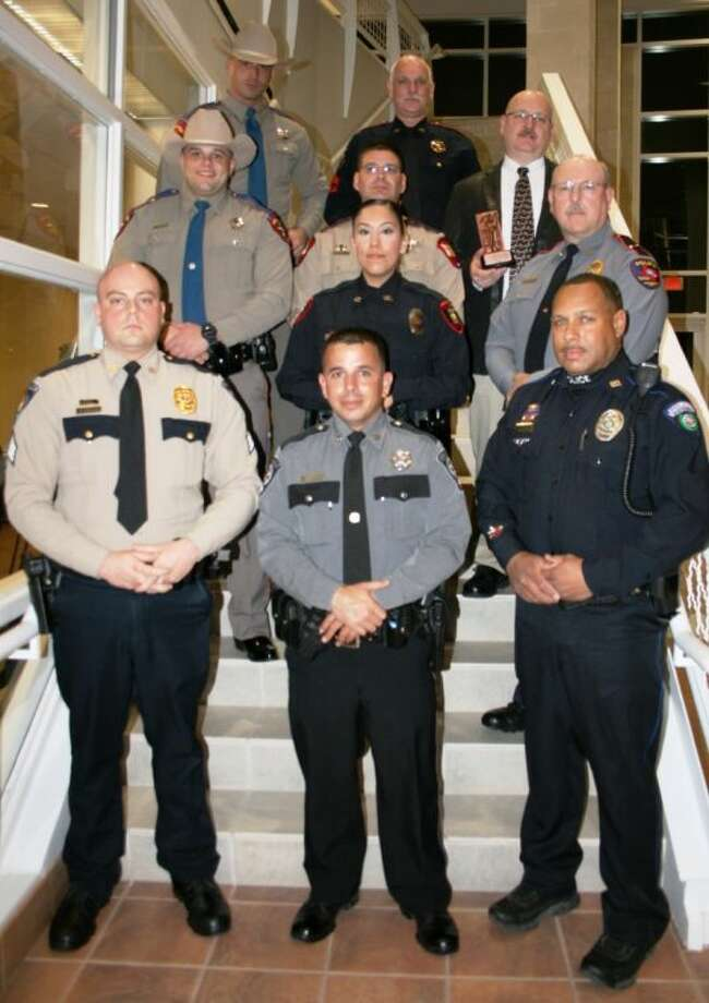 East Montgomery County law enforcement officers, including Deputy Jesse Bullinger, Detective Sgt. Steve Mullins, Deputy Robert Layman, Sgt. Dimitri Jasonis, Officer Phillip Balthazar, Lt. John Mays, Officer Lori Rodriguez, Sgt. Robert Meager, Sr., Troopers Derek Peterson and John Sullivan, all received Officer of the Year awards for their individual departments. Photo: STEPHANIE BUCKNER