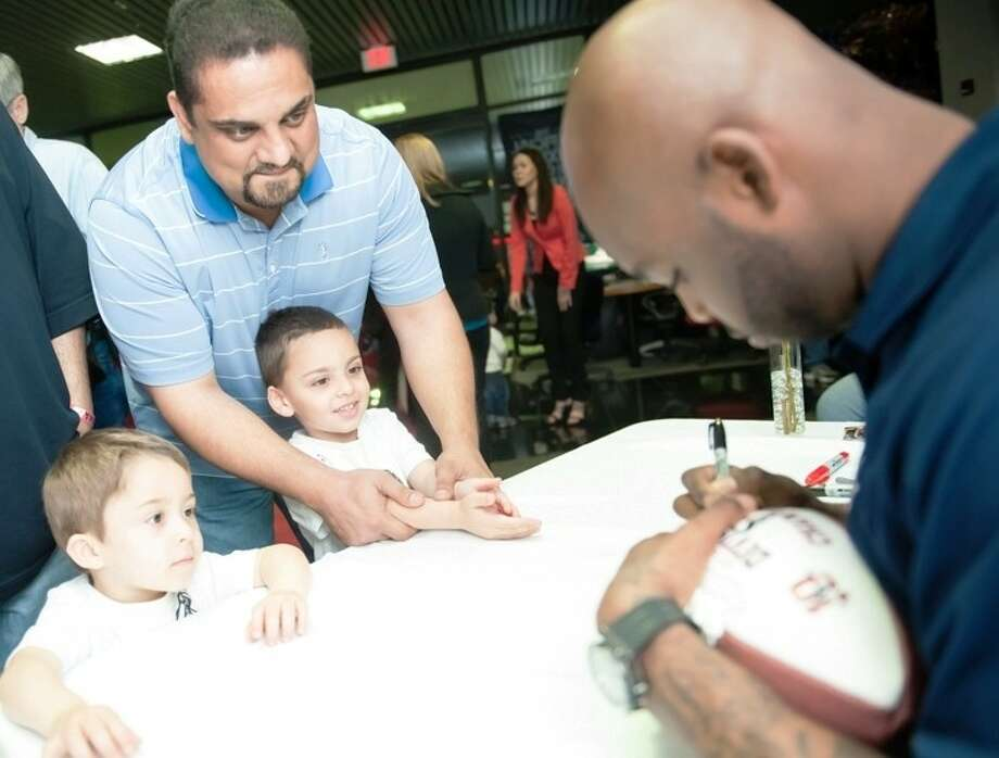Texans football player Johnathan Joseph greeted fans at Advantage BMW Clear Lake on the Gulf Freeway on Wednesday (February 20). Photo: CJ MARTIN