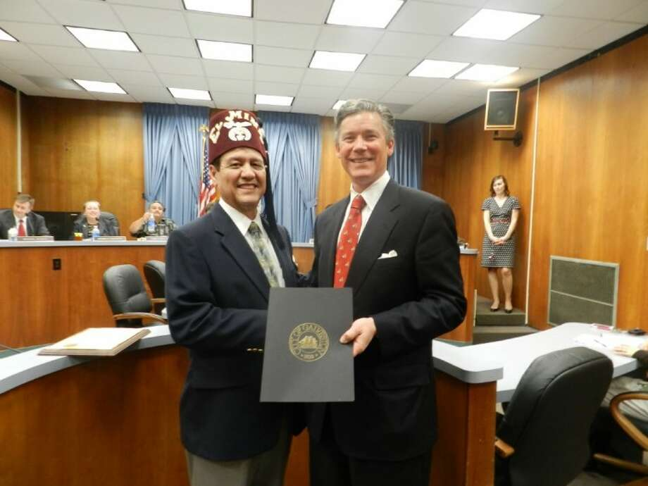 Shriners Hospitals for Children Board Member and former Texas City Mayor Carlos Garza appeared before Galveston City Council, Thursday, Feb. 23, and Mayor Joe Jaworski who presented him with a proclamation for the upcoming Tuesday, Feb. 28 IHOP/Shriners National Pancake Day. Photo: For The Citizen