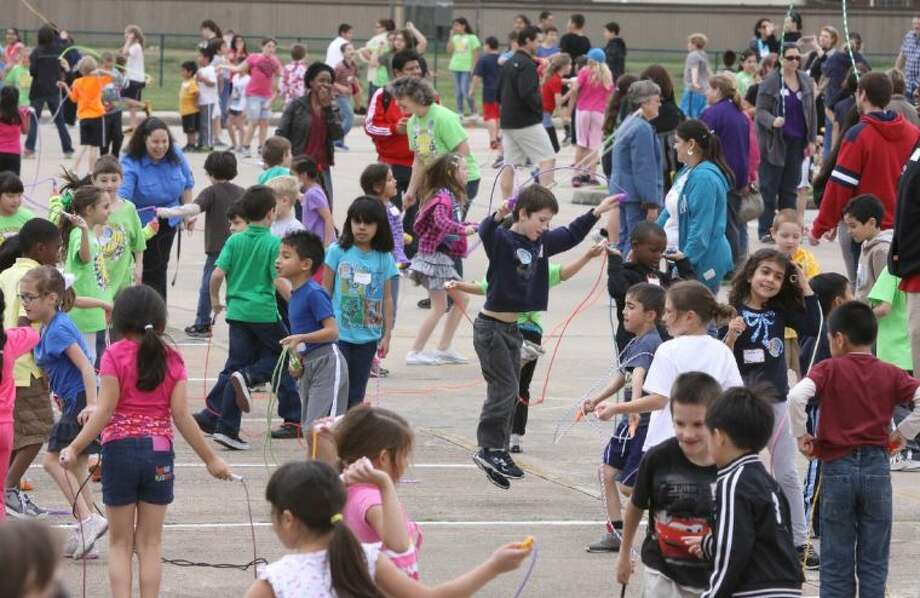 Students jump rope during the Jump Rope for Heart Fundraiser at Sugar Hill Elementary School in Sugar Land. Photo: Photo By Alan Warren